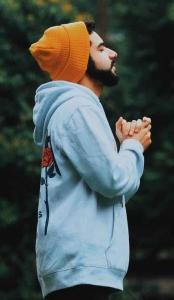 man wearing bonnet and hoodie