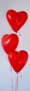 three red heart balloons