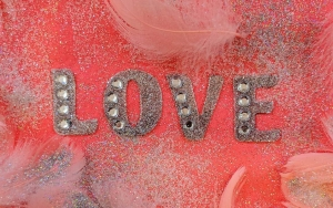 pink love fabric decor with feathers