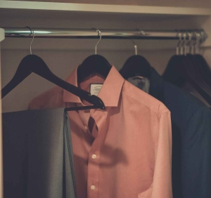 close up photo of hang clothes in wardrobe