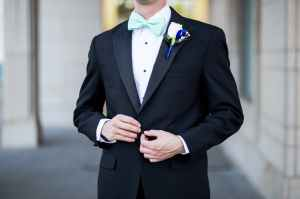 man wearing black and teal tuxedo