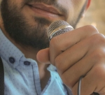 close up photo of man holding microphone