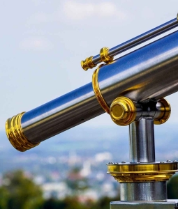 selective focus photography of a telescope