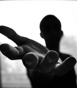 man s hand in shallow focus and grayscale photography