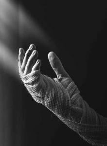 grayscale photography of person s hand covered with straps