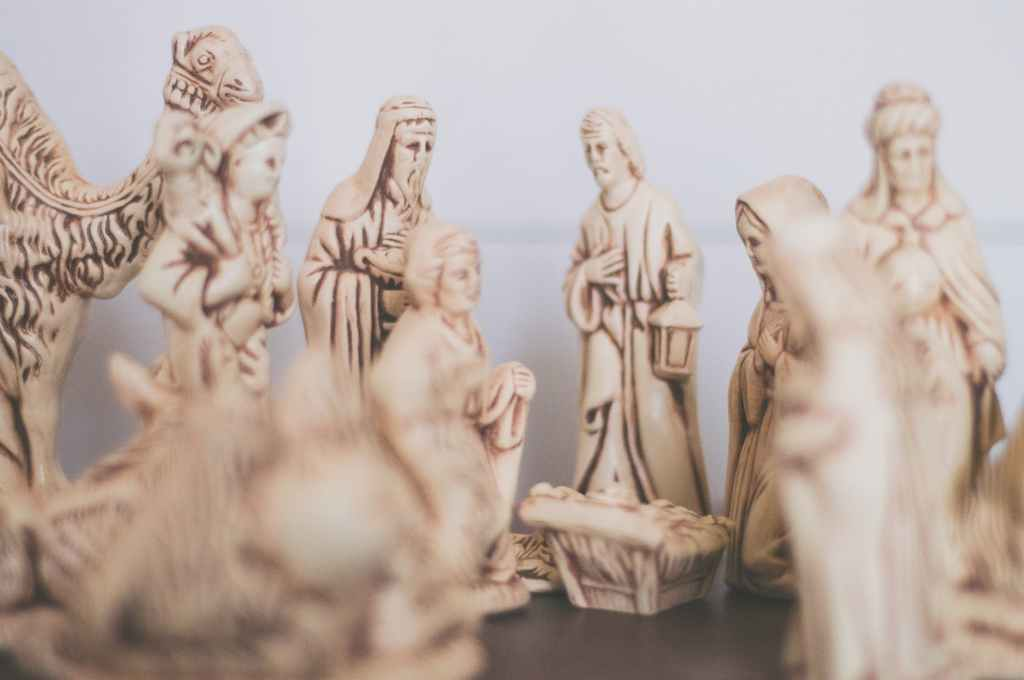 shallow focus photography of religious figurines