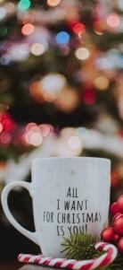 selective focus photography of ceramic mug near candy cane