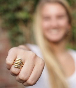 close up photo of woman wearing golden ring