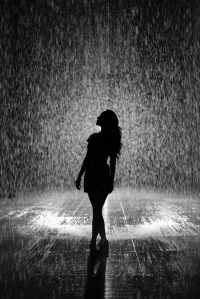 silhouette of woman under rain