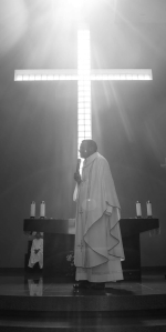 priest standing on a podium during mass