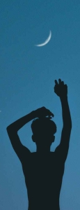 silhouette of person raising his hands