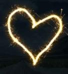 white light forming heart on black surface