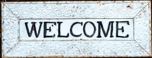 black and white wooden welcome sign