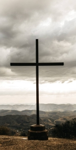 black cross on top of mountain
