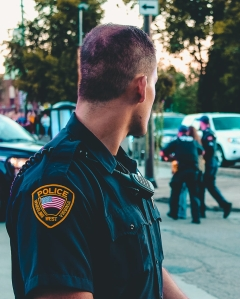 man wearing black officer uniform