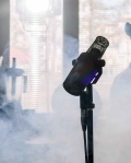 black microphone with stand near white smoke
